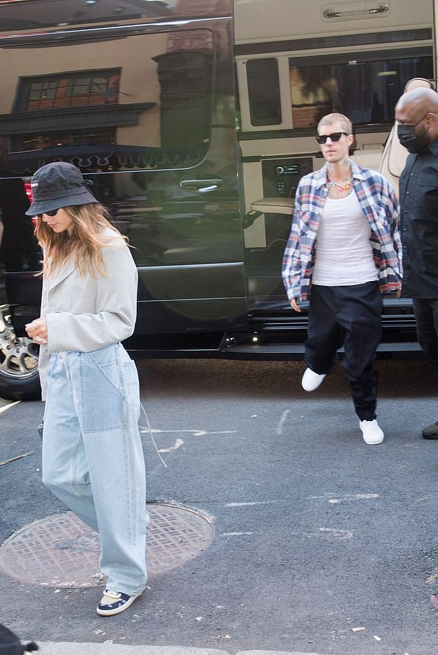 Hailey Baldwin donning round blue lace-up sneakers