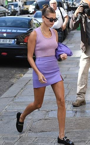 Hailey Bieber rocking a purple skinny figure hugging pencil skirt