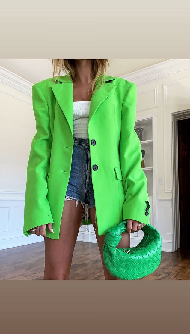 Hailey Baldwin donning a neon green unbuttoned blazer with lapel collar and button front