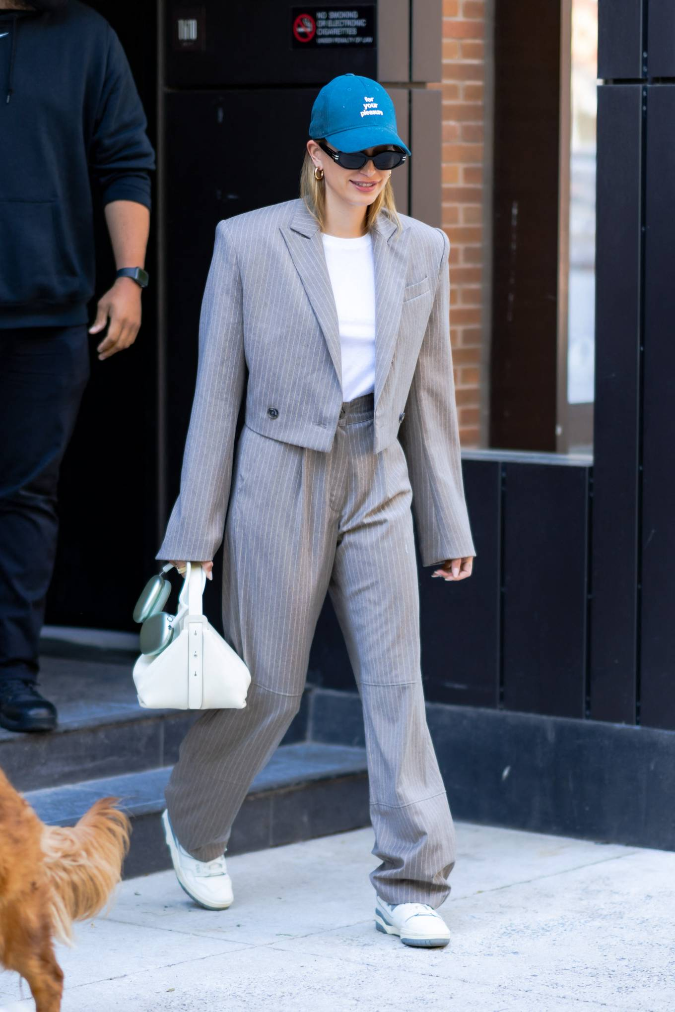Hailey Bieber donning round multicolor white lace-up sneakers by New Balance