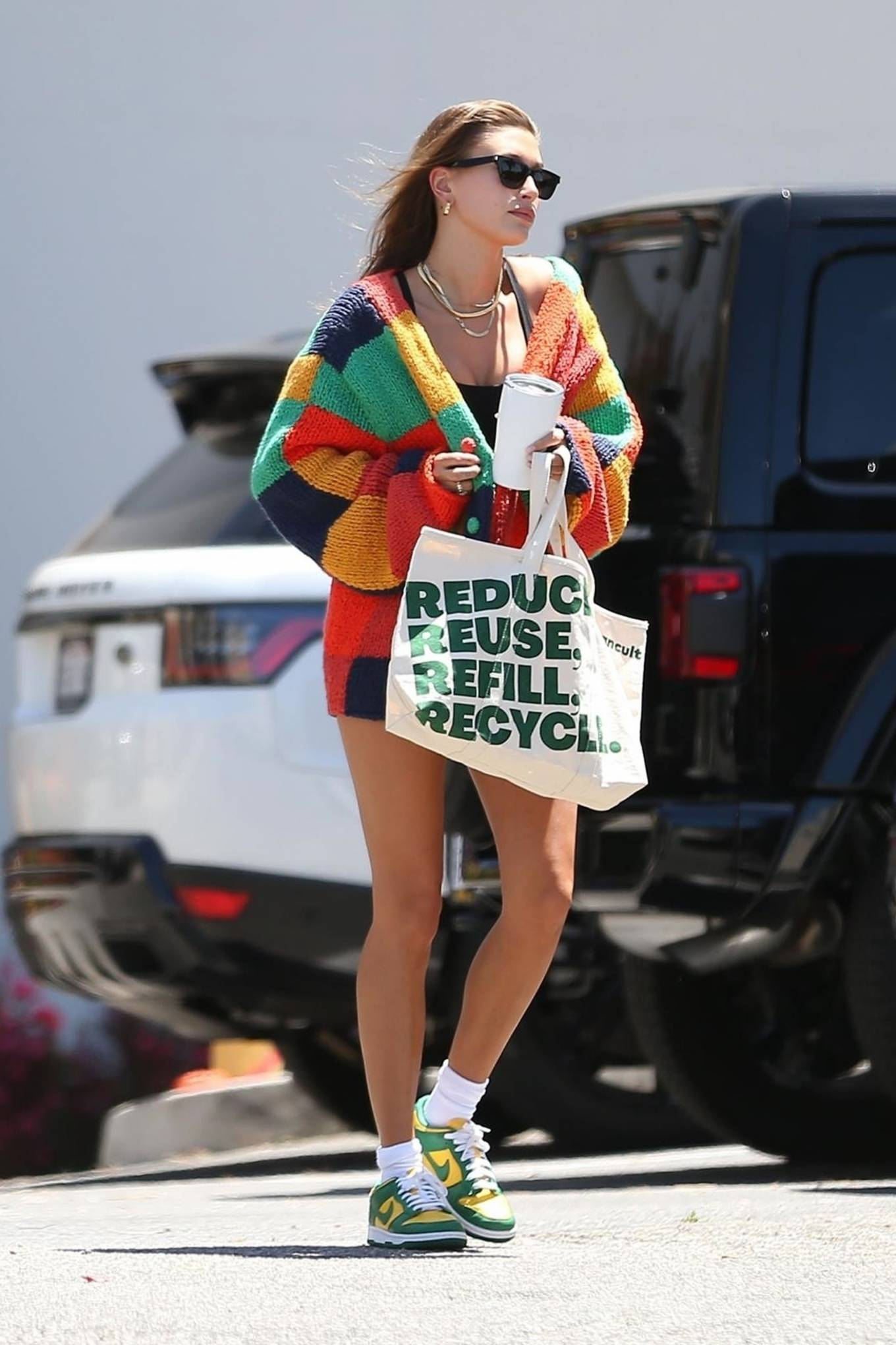Hailey Bieber donning a oversized color block The Elder Statesman cotton cardigan with balloon sleeves and a V-neck