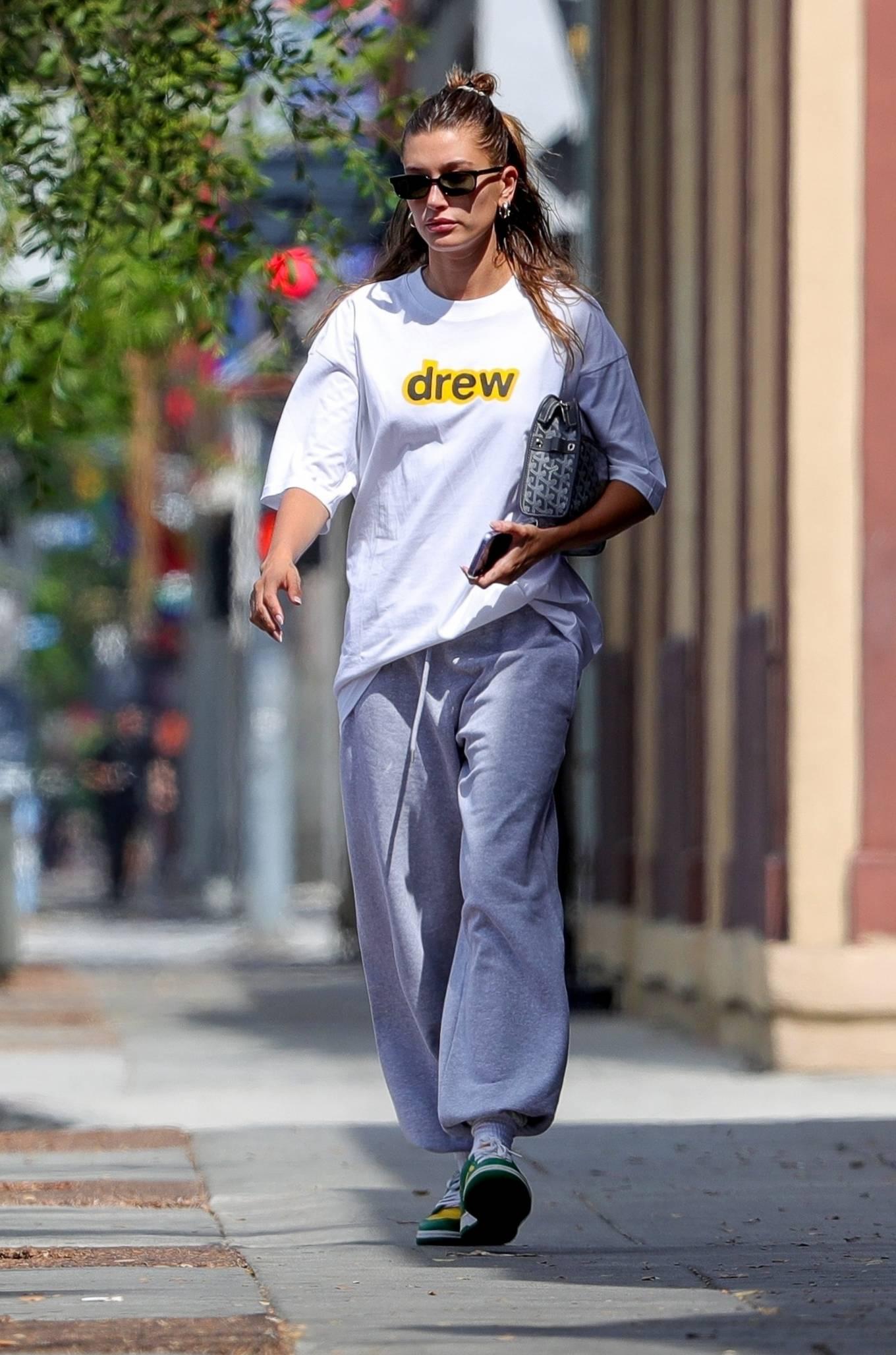 Hailey Baldwin wearing brand logo green yellow lace-up sneakers by Nike