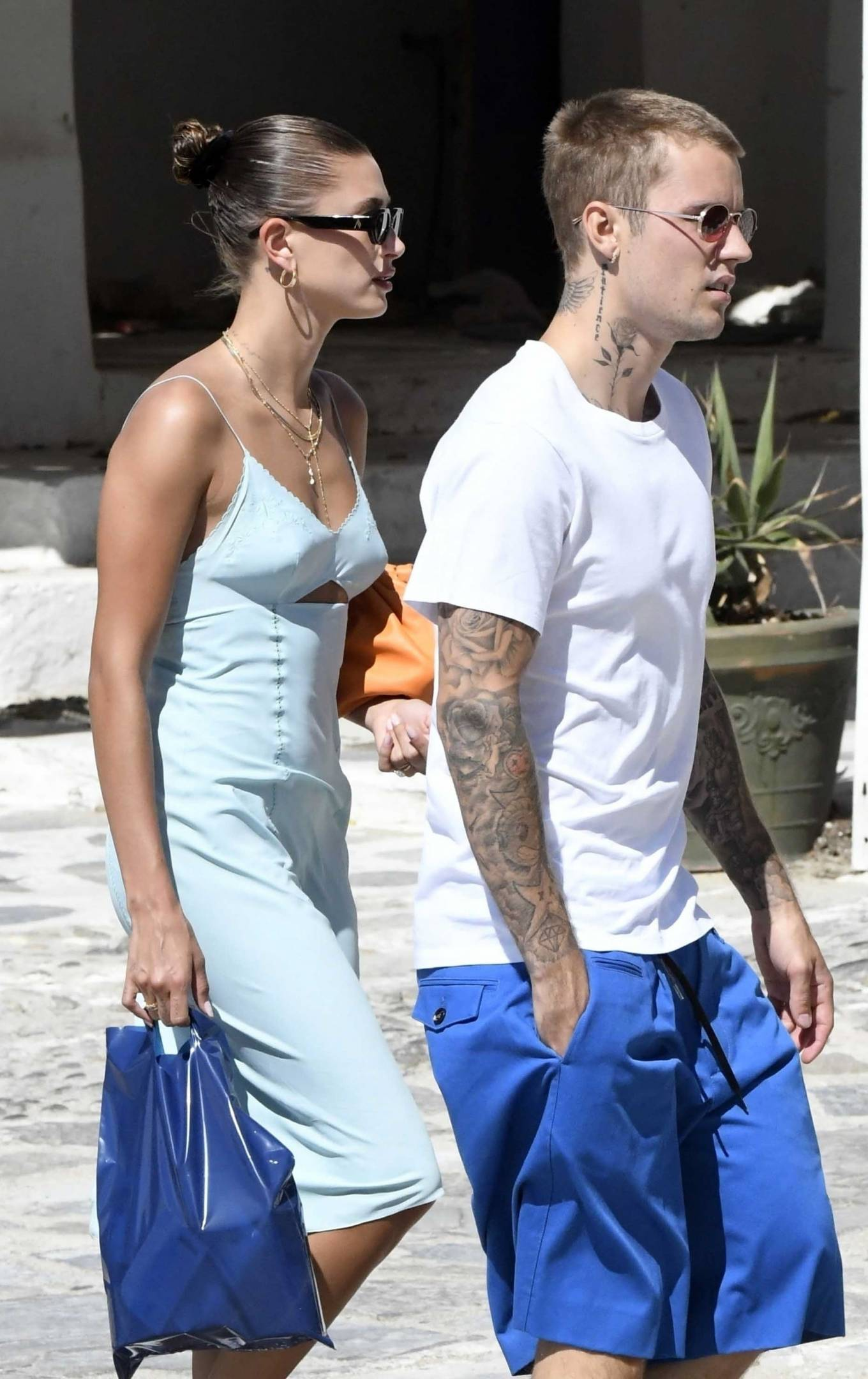 Hailey Baldwin donning round white lace-up sneakers