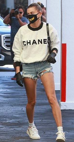 Hailey Baldwin donning ripped blue denim daisy dukes