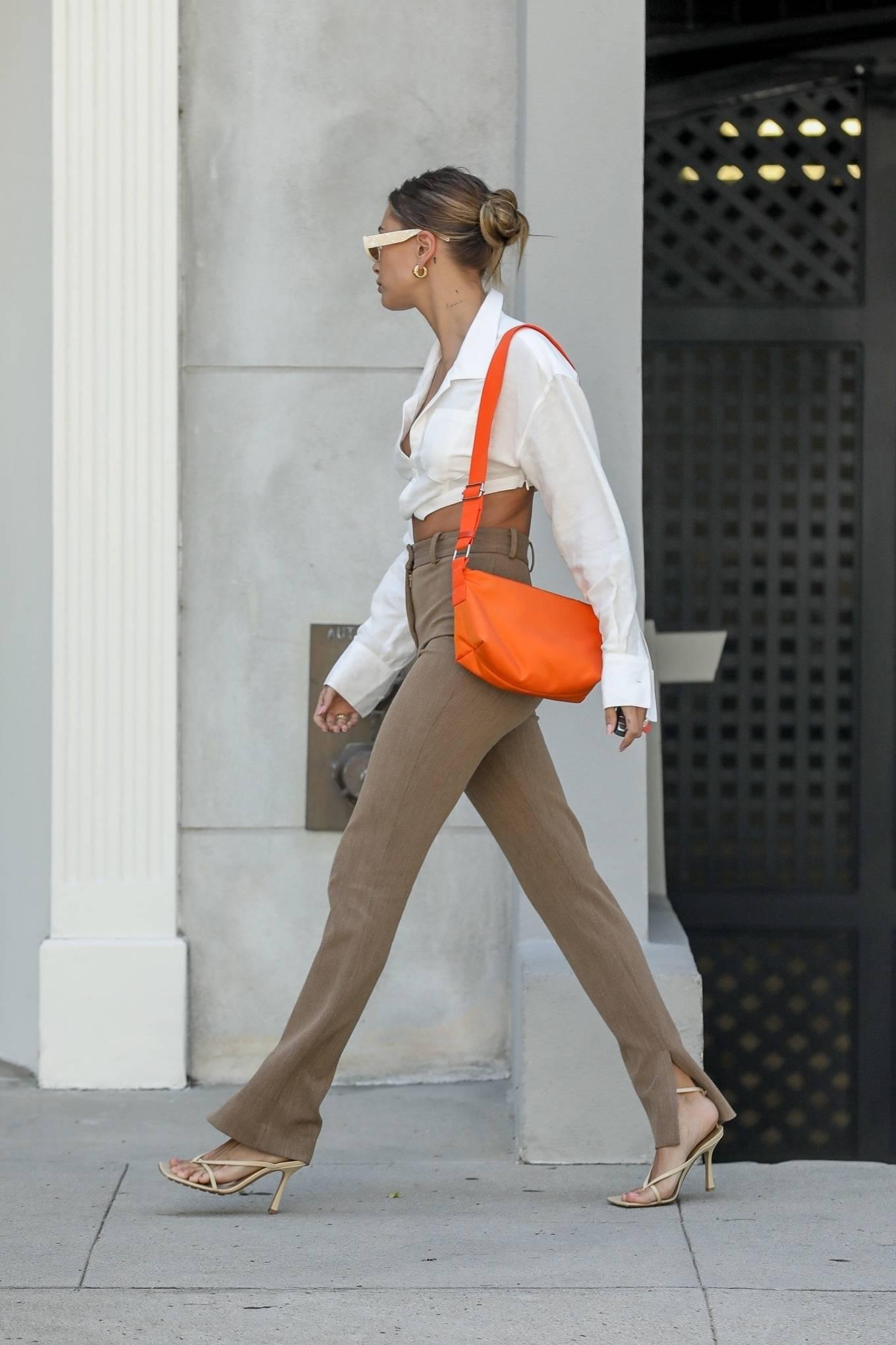 Hailey Baldwin rocking strappy beige Bottega Veneta ankle sandals with high heel
