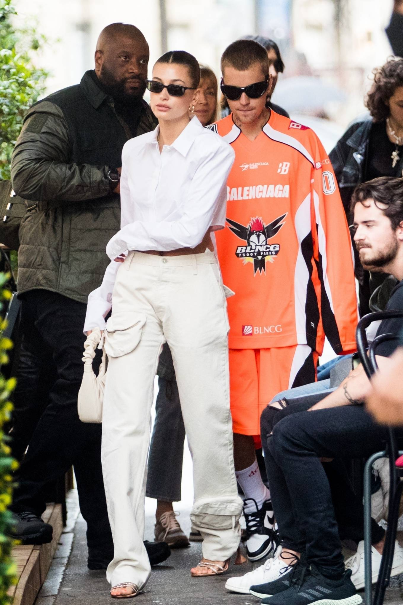 Hailey Baldwin wearing crystal encrusted brown leather slip on sandals by Amina Muaddi with high heel