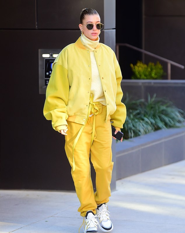 Hailey Baldwin donning a clinging Light yellow jumper with a turtleneck