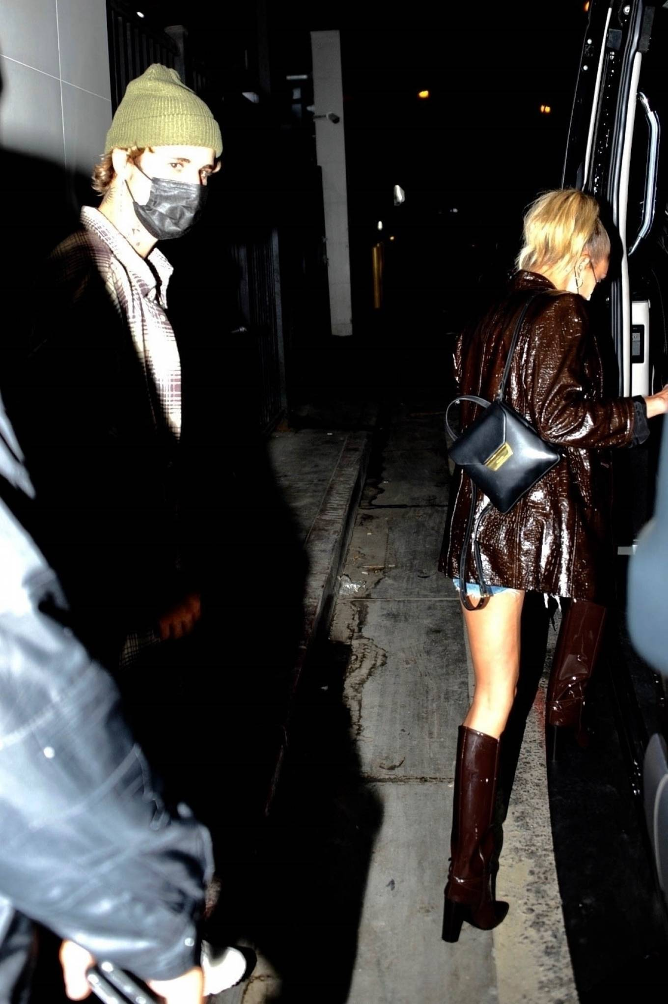 Hailey Baldwin wearing brown Saint Laurent knee high boots