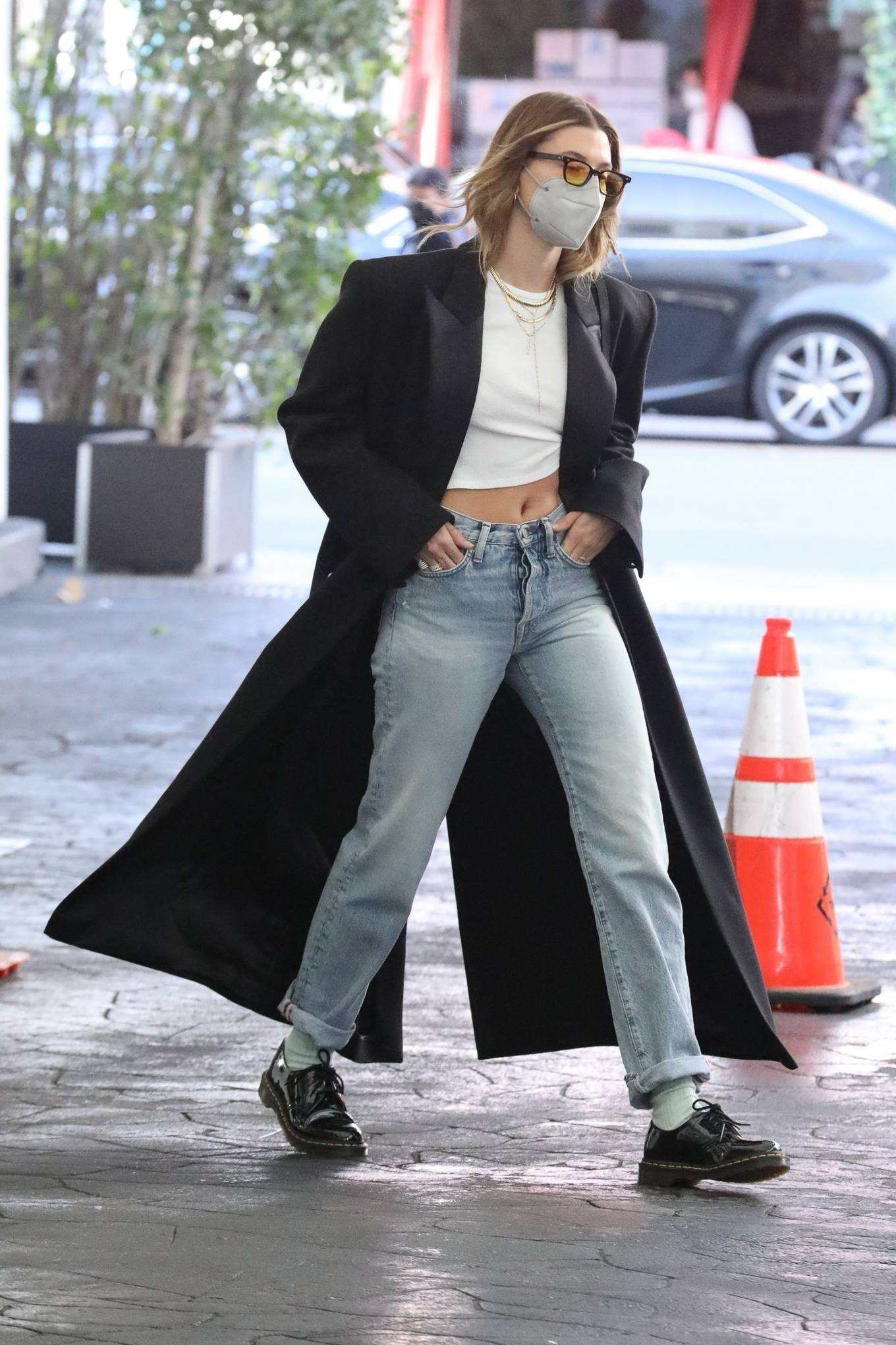 Hailey Bieber rocking round black leather lace-up shoes by Dr. Martens with flat heel