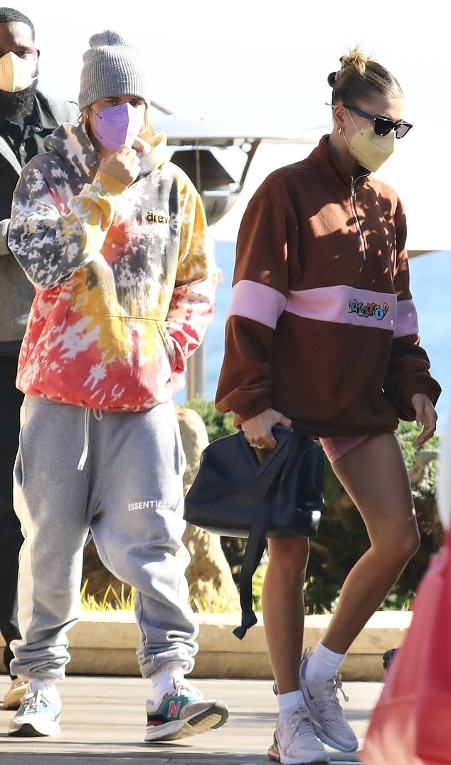 Hailey Baldwin donning brand logo pink Nike lace-up sneakers