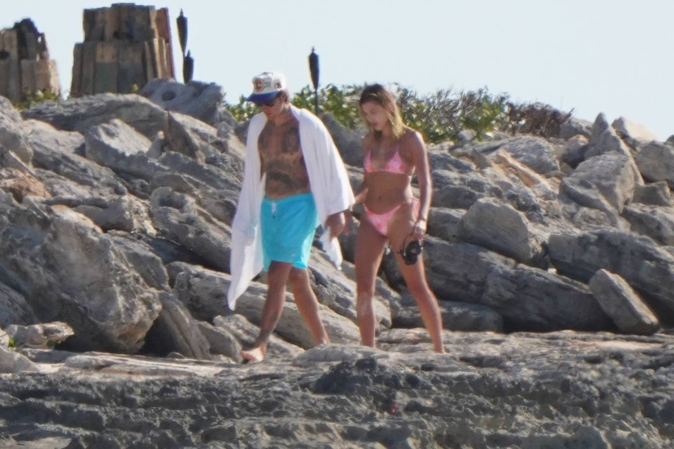 Hailey Baldwin, velvet, TRIANGL bikini top, straps tied at the shoulder, plunging neck, skimpy, floral, tiny, tie back, sexy. Hailey Baldwin wearing a plunging velvet bikini top with tie back, floral print and two ties at the shoulder