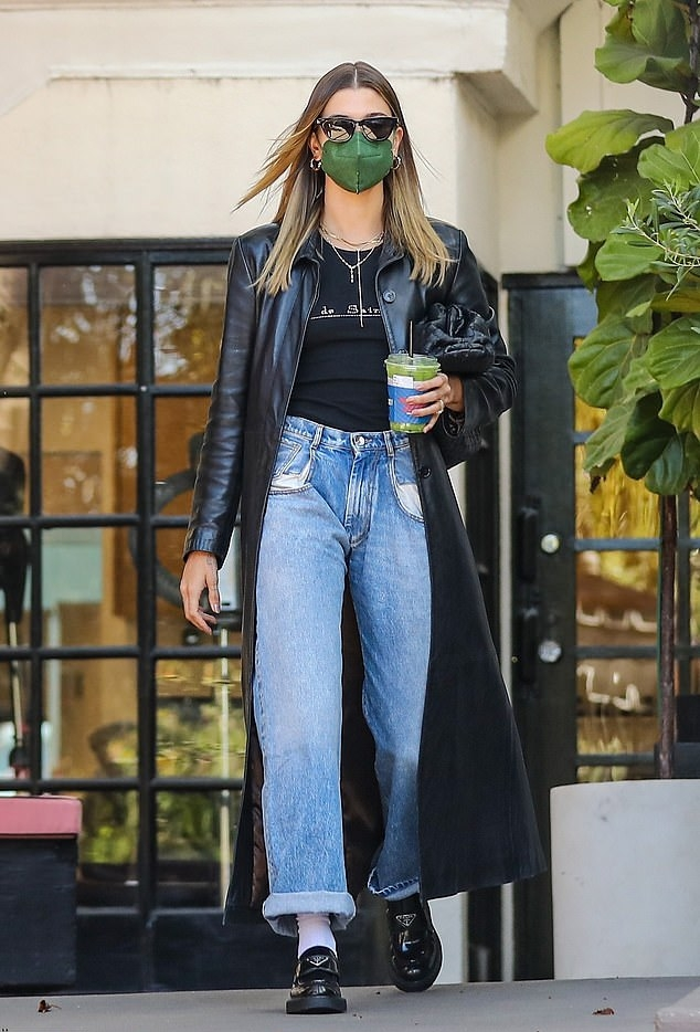 Hailey Baldwin wearing brand logo black Prada slip on loafers with platform heels
