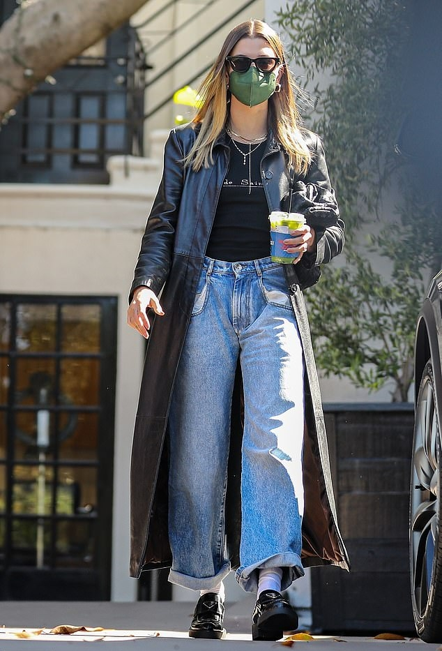 Hailey Baldwin, Prada  loafers, black  loafers, leather, black coat, black Bottega Veneta clutch, platform heels, round, slip on, black tank top, black Saint Laurent sunglasses, brand logo, light blue Maison Margiela jeans