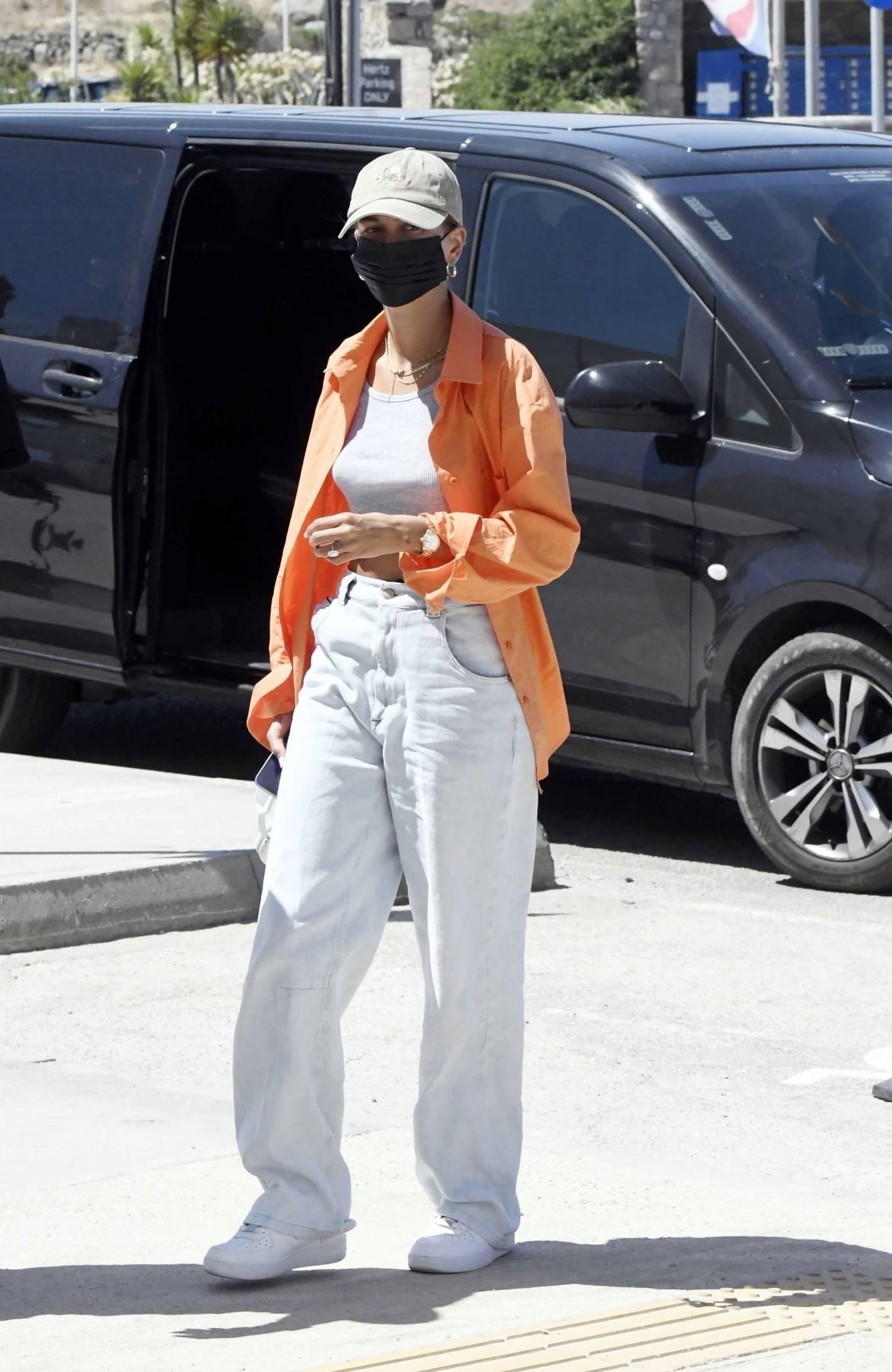Hailey Bieber rocking baggy white high rise jeans