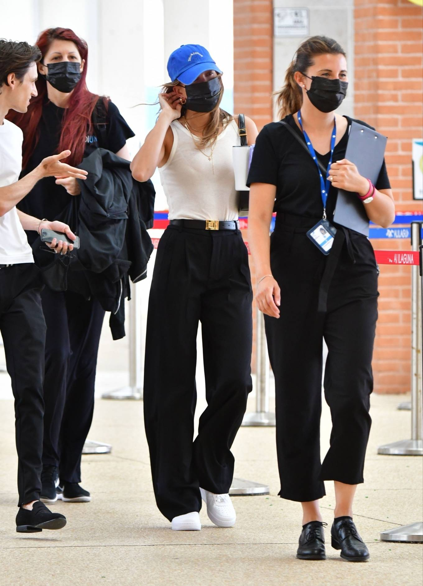 Hailey Baldwin rocking relaxed fit black woolen pleated trousers with low rise
