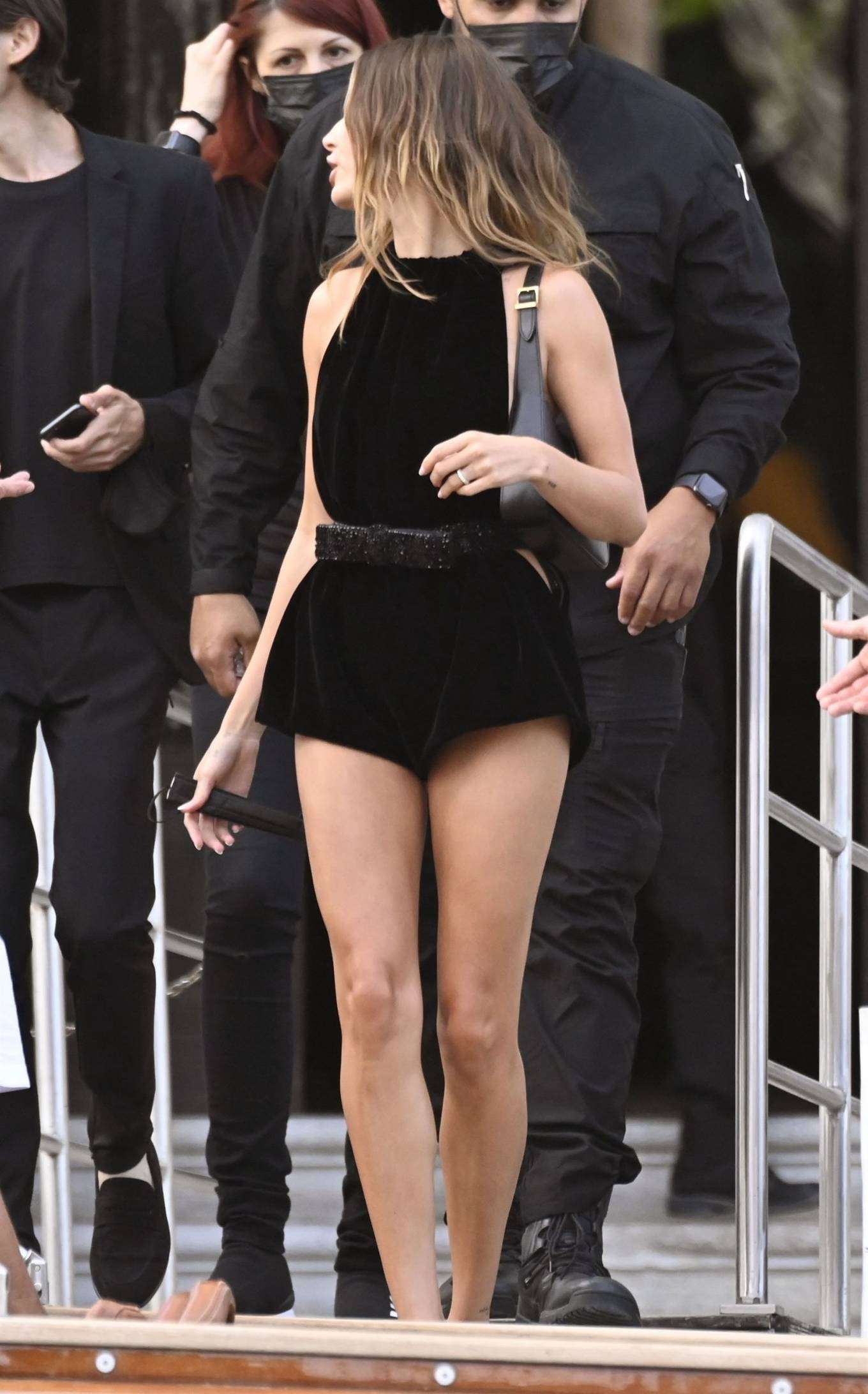 Hailey Bieber wearing a comfortable black jumpsuit with a halter neck