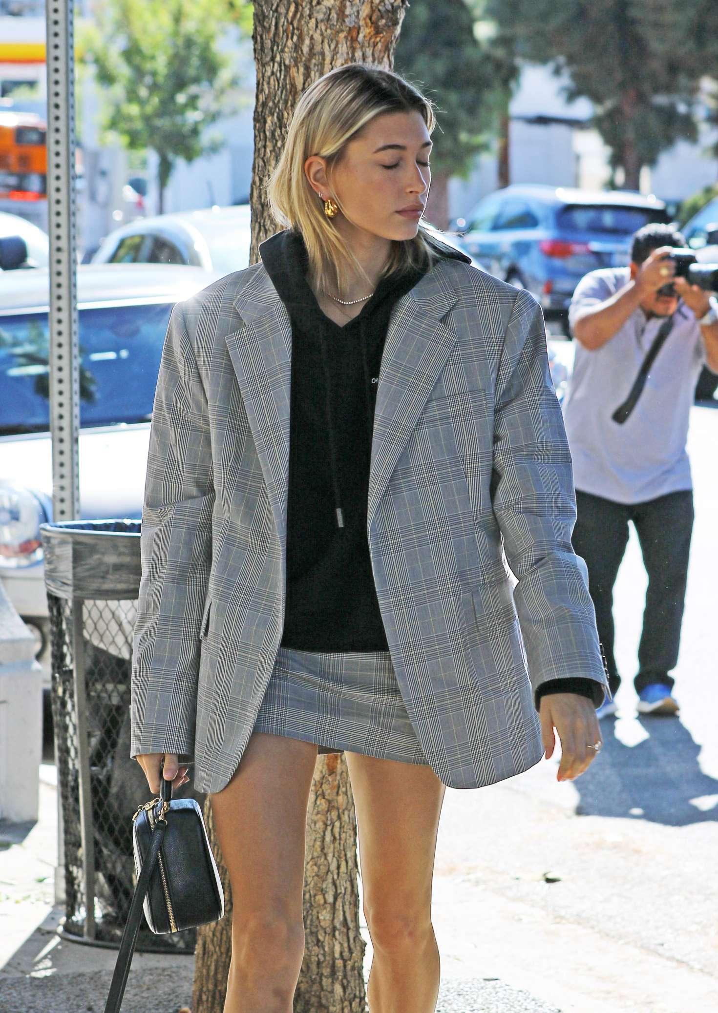 Hailey Baldwin donning a grey close fitting matching pencil skirt