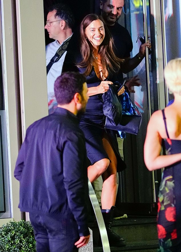 Irina Shayk rocking a plunging black dress by designer Bottega Veneta while out and about in New York