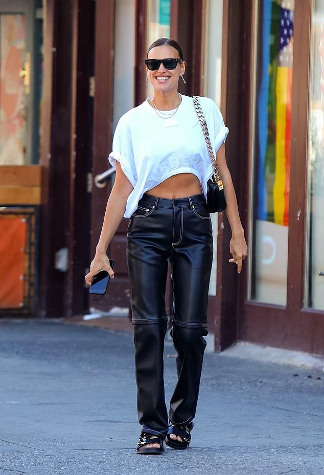 Irina Shayk donning straight fit black high waist jeans