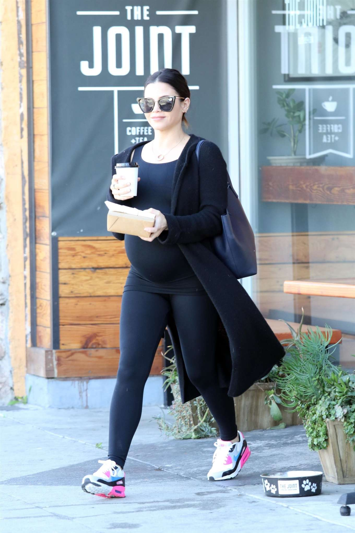 Jenna Dewan donning white leather lace-up sneakers