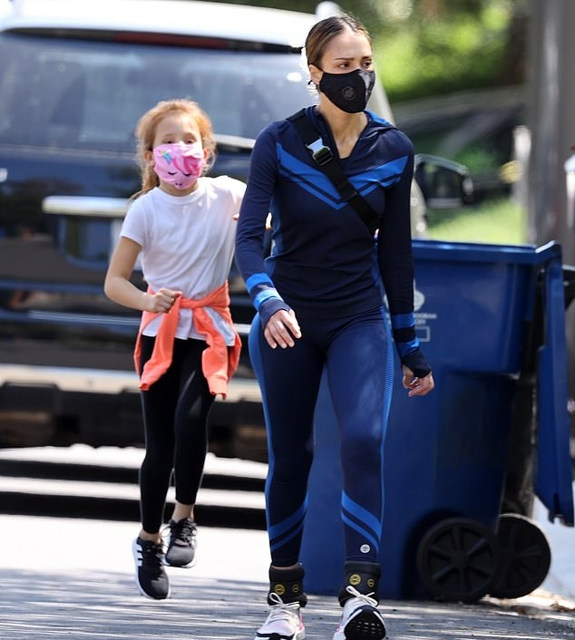 Jessica Alba rocking Skinny dark blue Tory Burch polyester side striped leggings with side-stripes and a polyester material