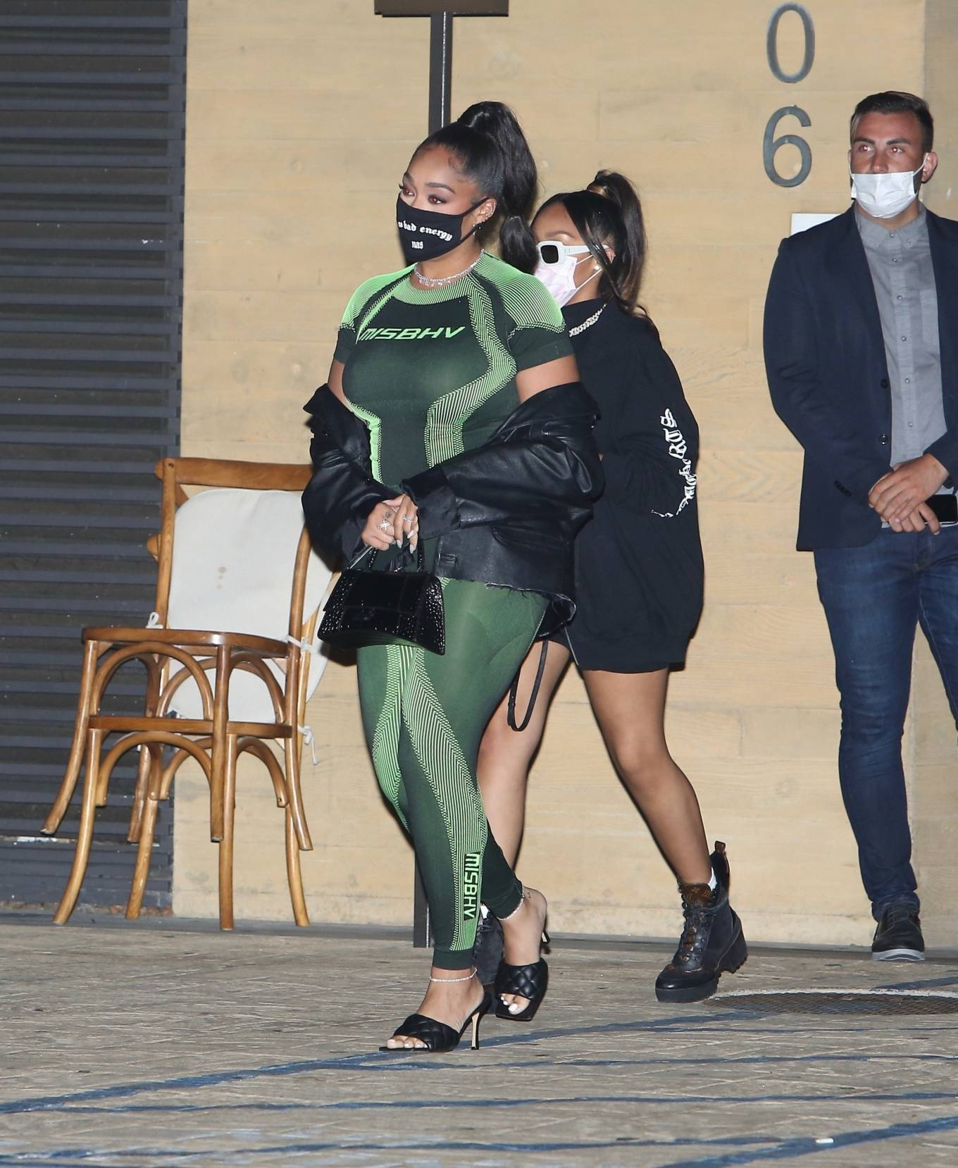 Jordyn Woods rocking Skinny green striped MISBHV pattern leggings with high waist with striped pattern