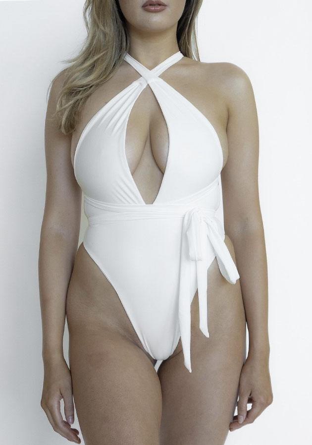 Jordyn Woods donning a White Nude Swim one piece with knotted and cinched waist