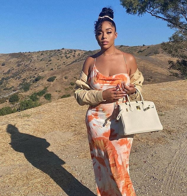 Jordyn Woods donning strappy Nude leather sandals with pointy heel and thin straps