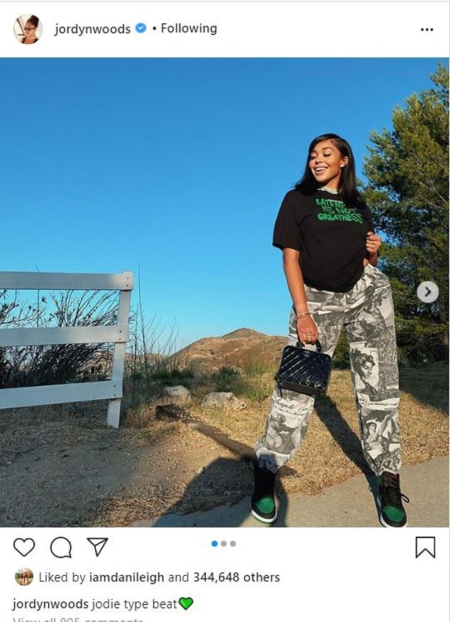 Jordyn Woods donning black green lace-up sneakers