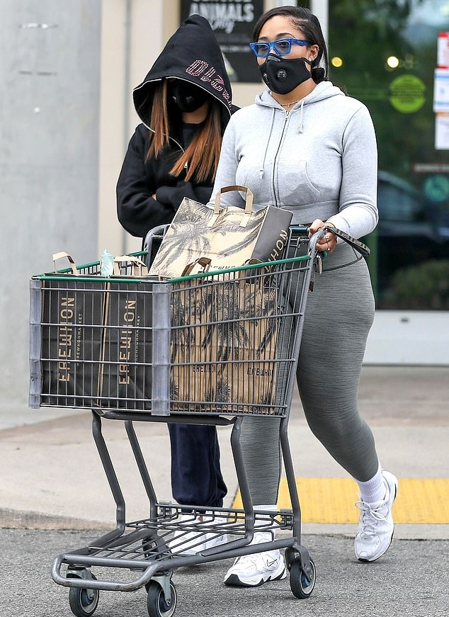 Jordyn Woods wearing a Casual grey hooded crop jacket with full sleeves and ribbed trim hem