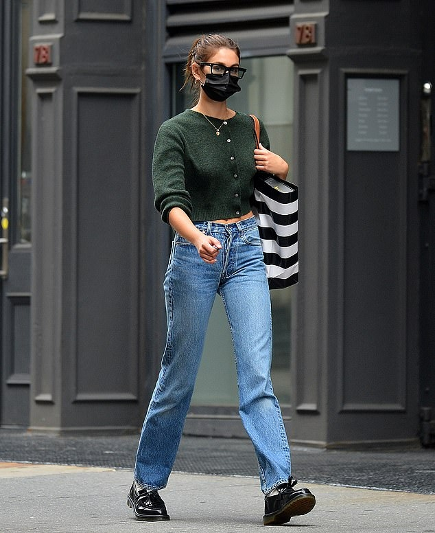 Kaia Gerber rocking round black leather boots by Adrian