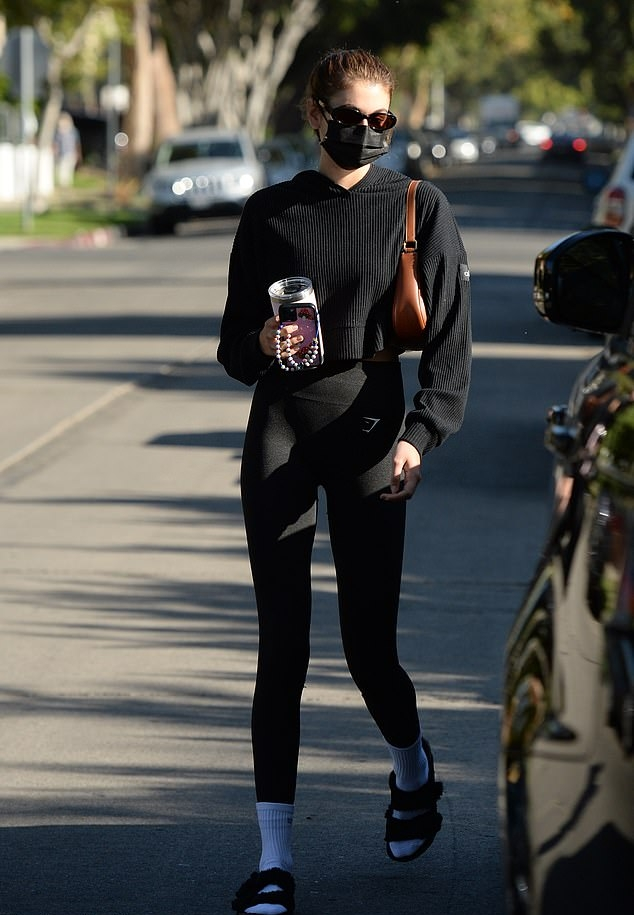 Kaia Gerber rocking round black suede slip on slippers by Birkenstock with flat heel and wide strap