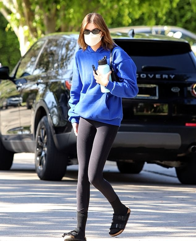 Kaia Gerber wearing round black suede open toe sandals by Birkenstock while heading to Pilates in Los Angeles