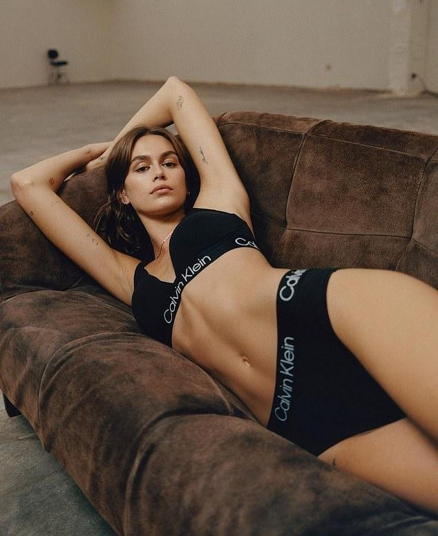 Kaia Gerber wearing matching black high rise brief by Calvin Klein with logo waistband