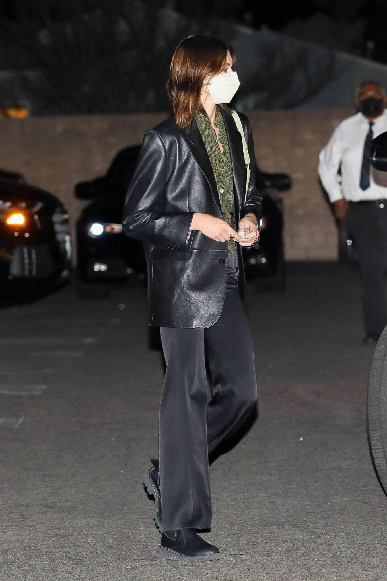 Kaia Gerber rocking a plunging olive green top with button front