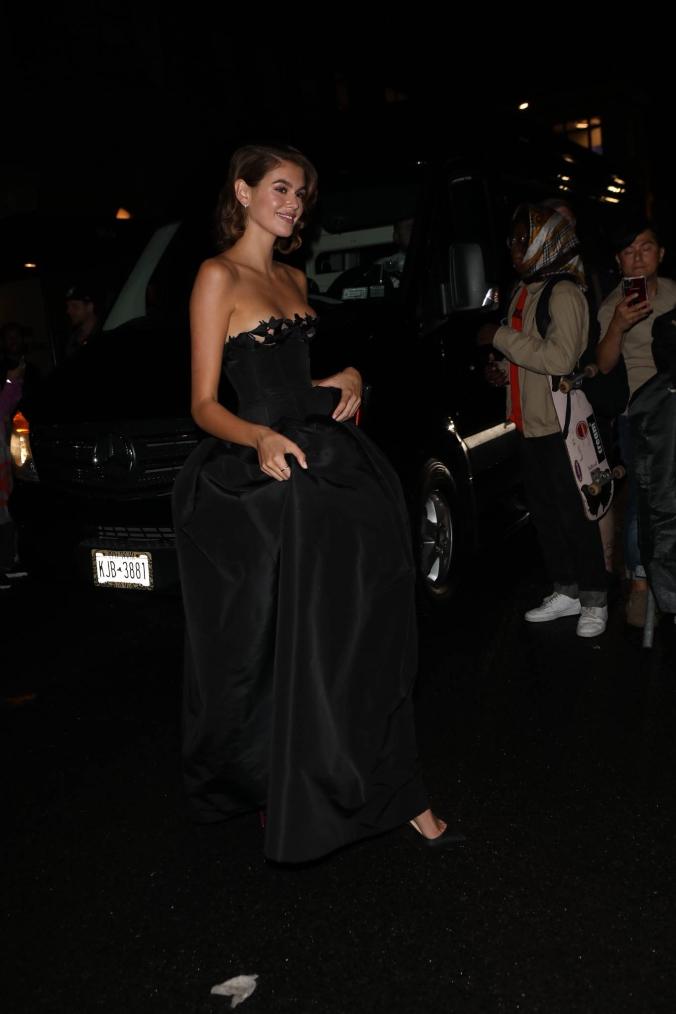 Kaia Gerber wearing pointed black Christian Louboutin slip on pumps with stiletto heels