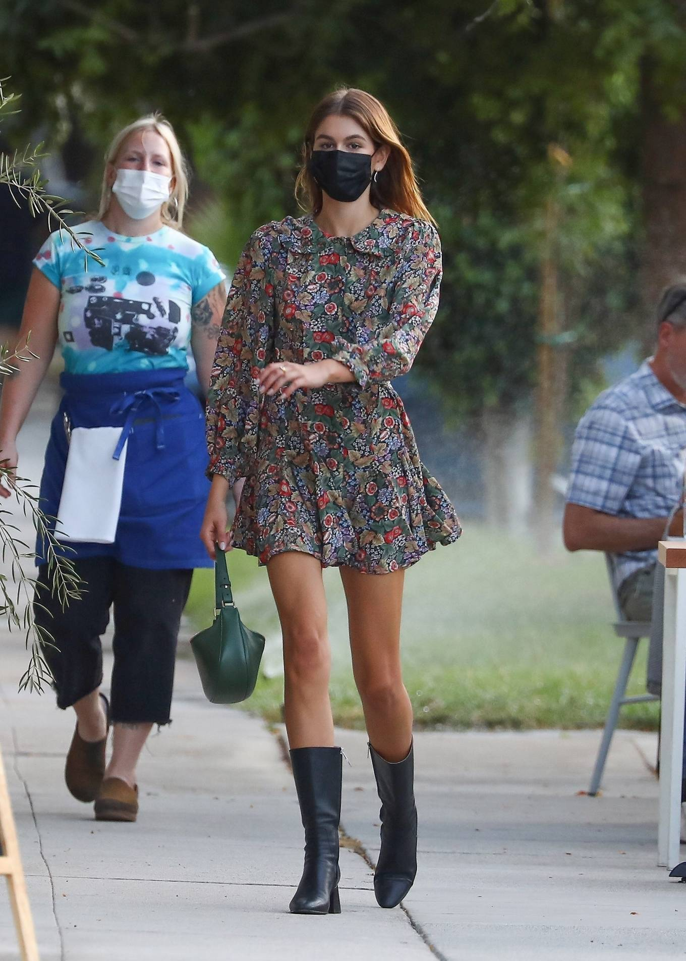 Kaia Gerber donning a flowing shirt dress with a viscose fabric, puffy sleeves, shirt collar and floral print