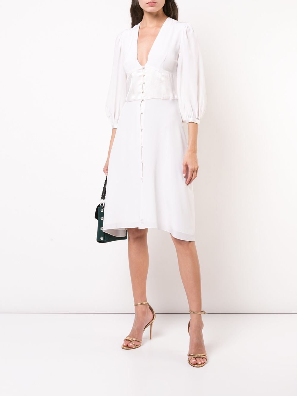 Kaia Gerber wearing a Sleek shiny white Fleur Du Mal midi dress with a satin fabric, elbow length sleeves, button front, a V-neck and flared hem