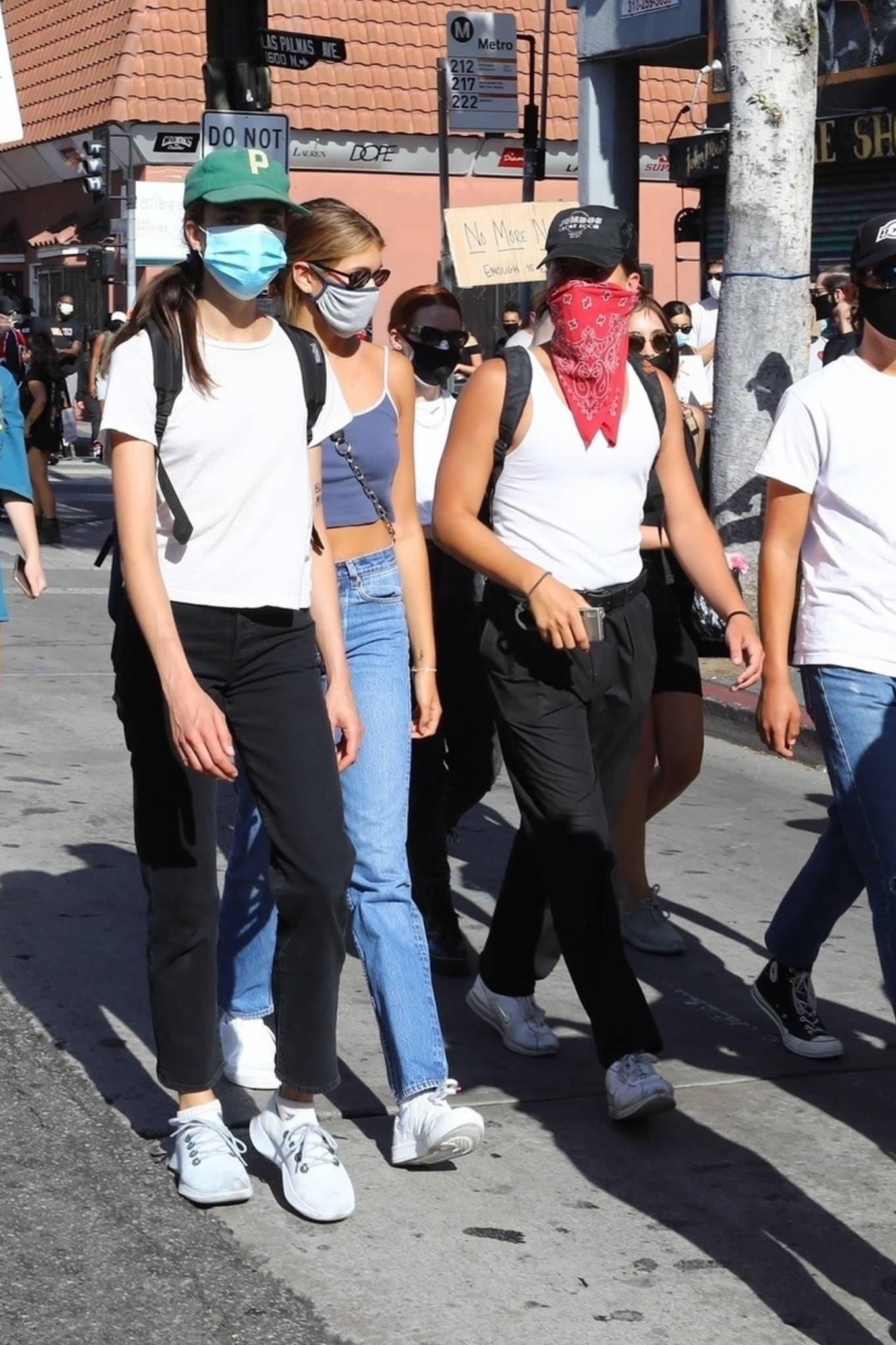 Kaia Gerber rocking a grey basic tank top with thin shoulder strap and a scoop neck