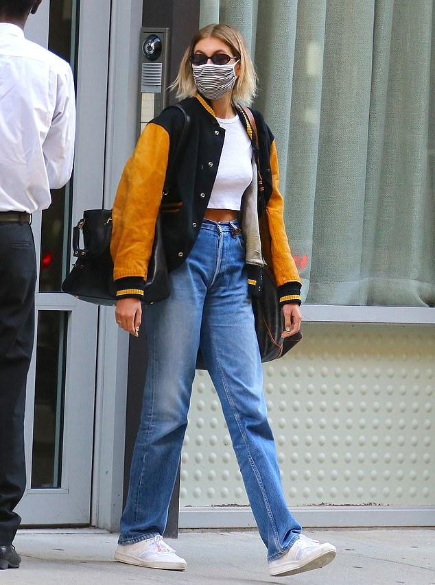 Kaia Gerber rocking a White cotton crop top with a cotton fabric and a round neck