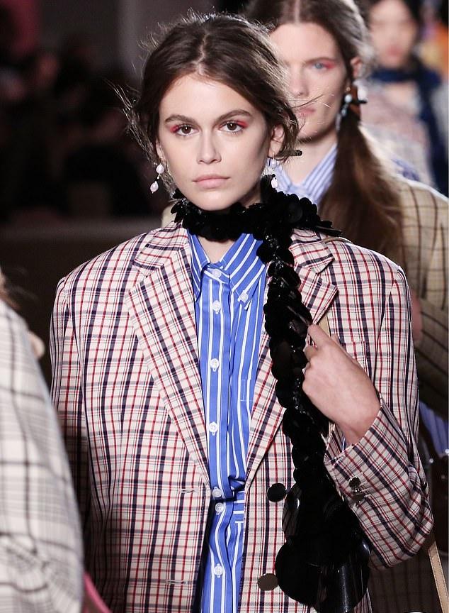 Kaia Gerber wearing a Blue Prada shirt with shirt collar and striped