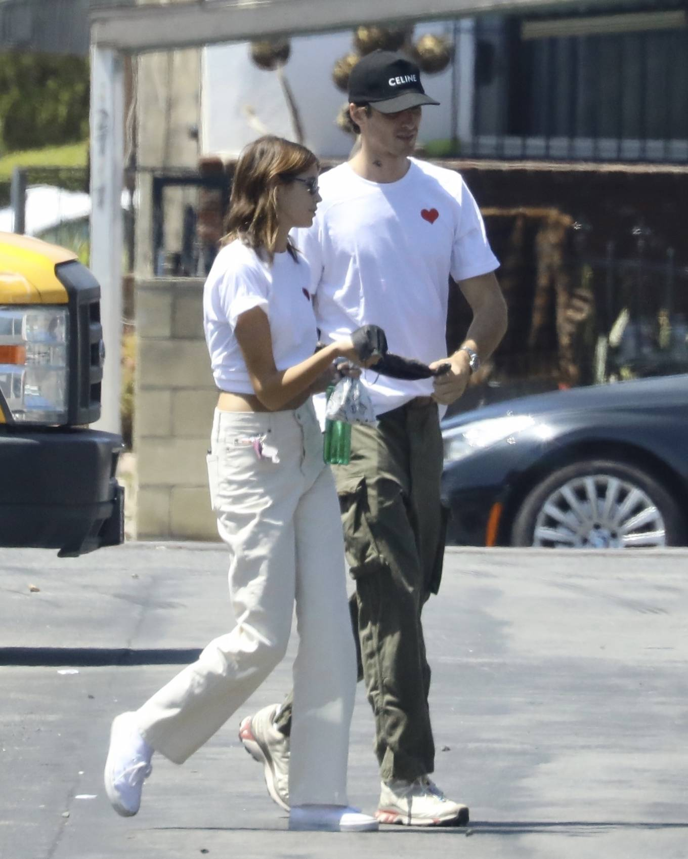 Kaia Gerber wearing round white off white lace-up sneakers by Vans with flat heel