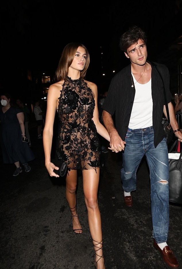 Kaia Gerber rocking strappy brown black crisscross tie sandals with high heel