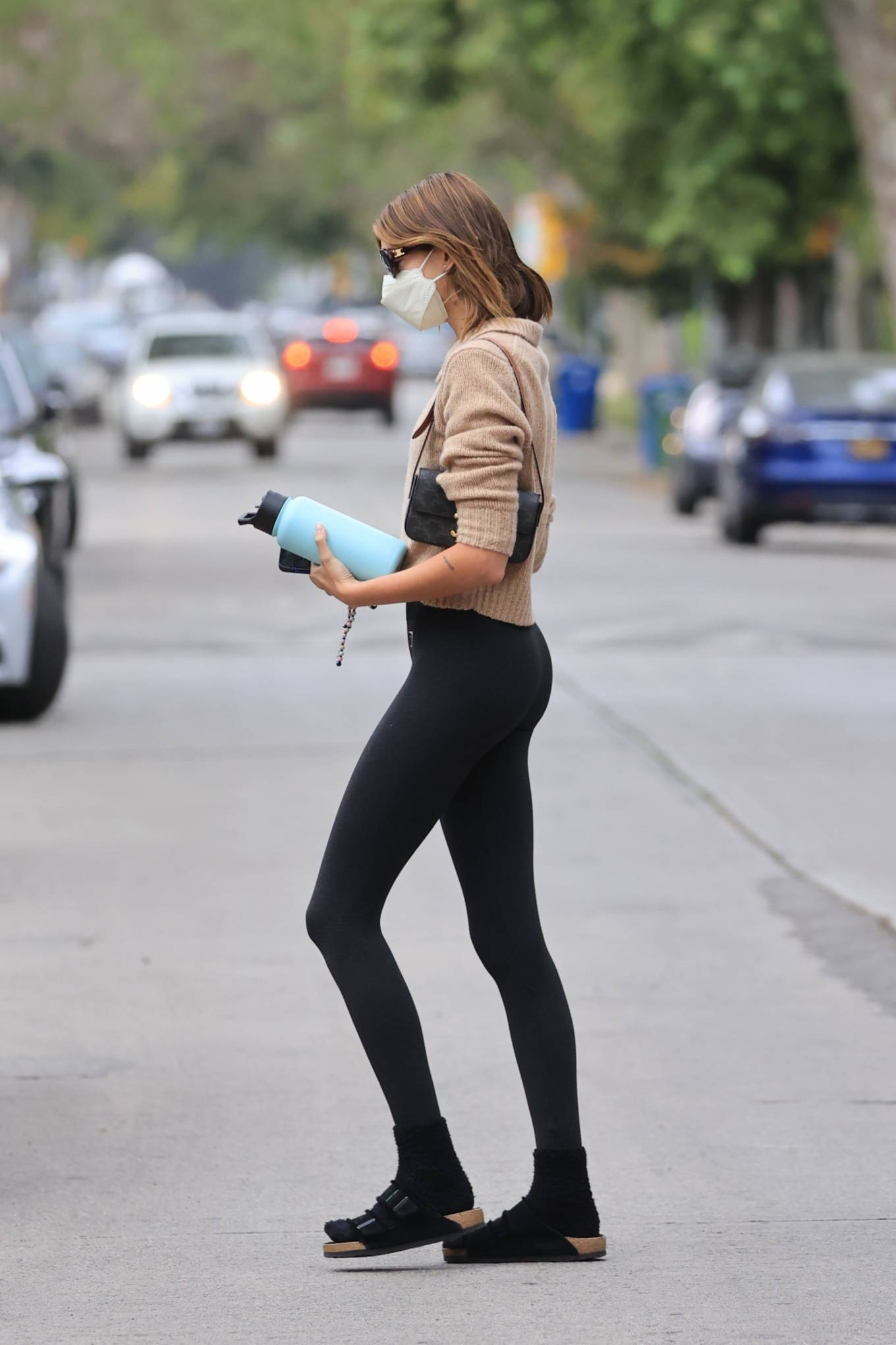 Kaia Gerber rocking figure hugging black nylon high rise workout leggings with brand logo and a polyester material