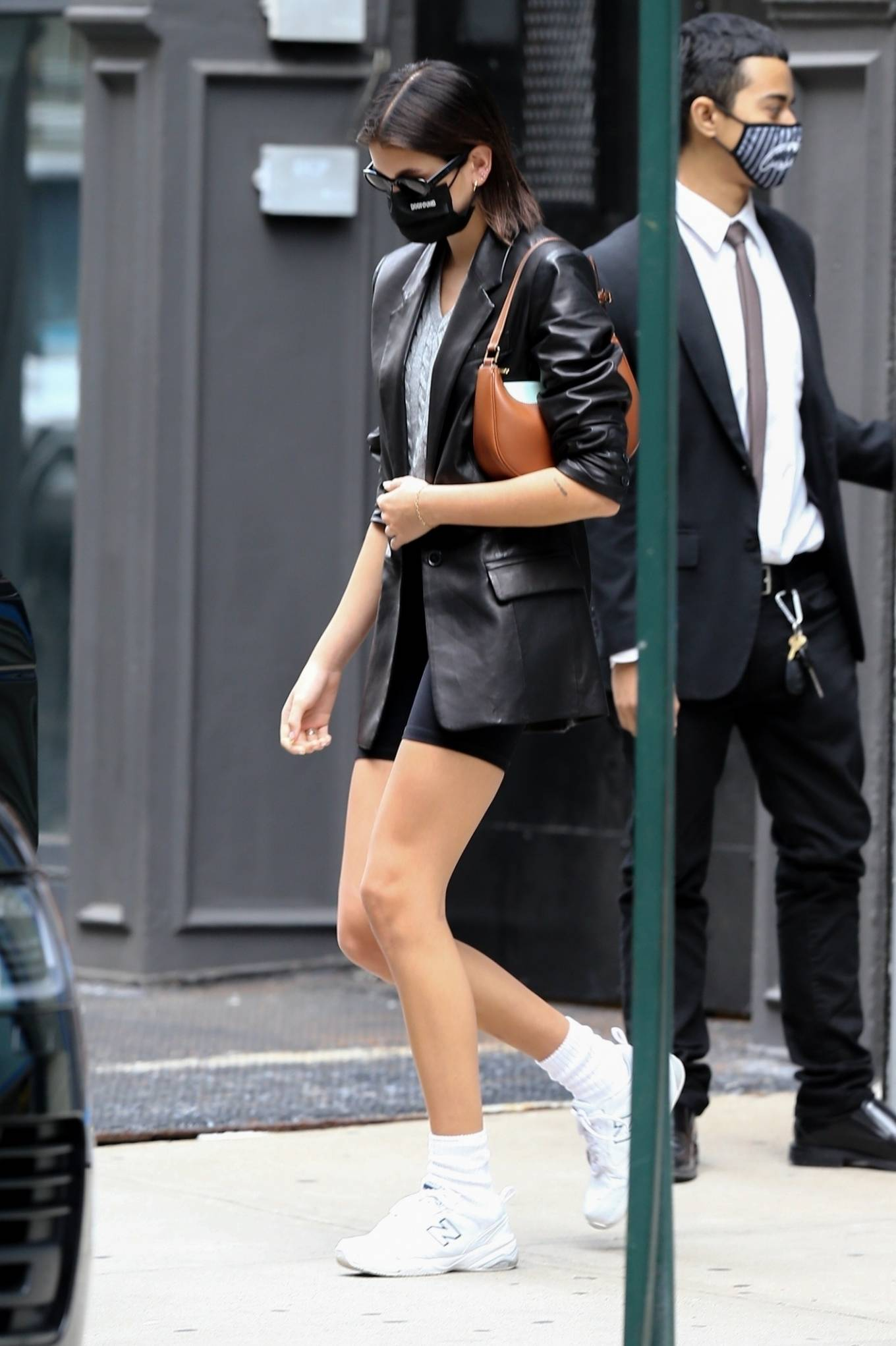 Kaia Gerber donning black skinny bicycle shorts