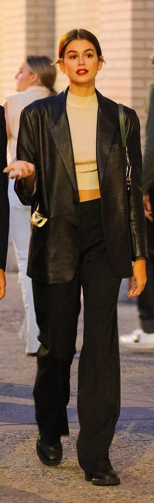 Kaia Gerber rocking round black leather ankle chelsea boots by Celine with cuban heel