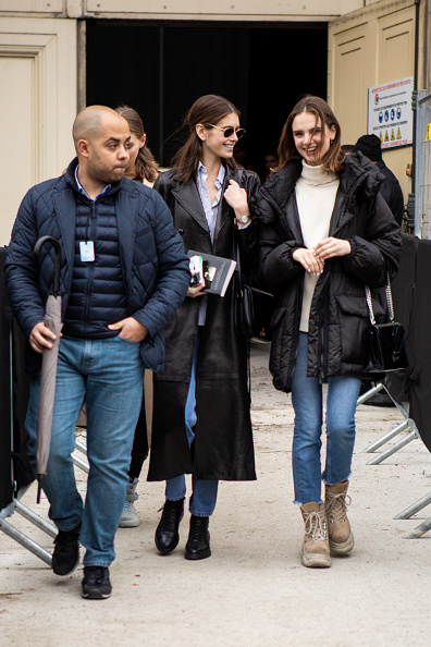 Kaia Gerber rocking a blue cotton shirt with full sleeves, shirt collar and button front