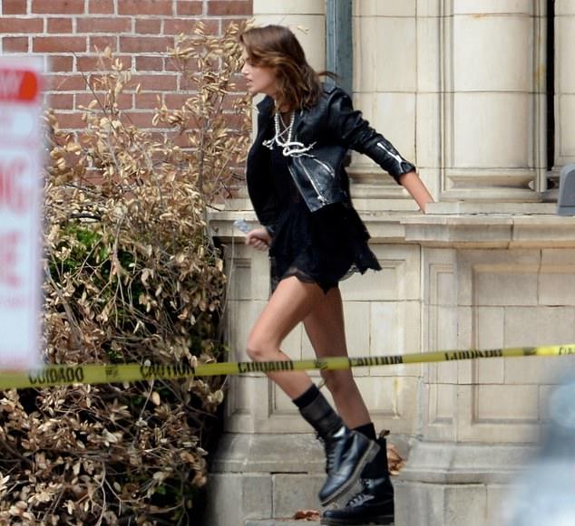 Kaia Gerber wearing round black knee high booties