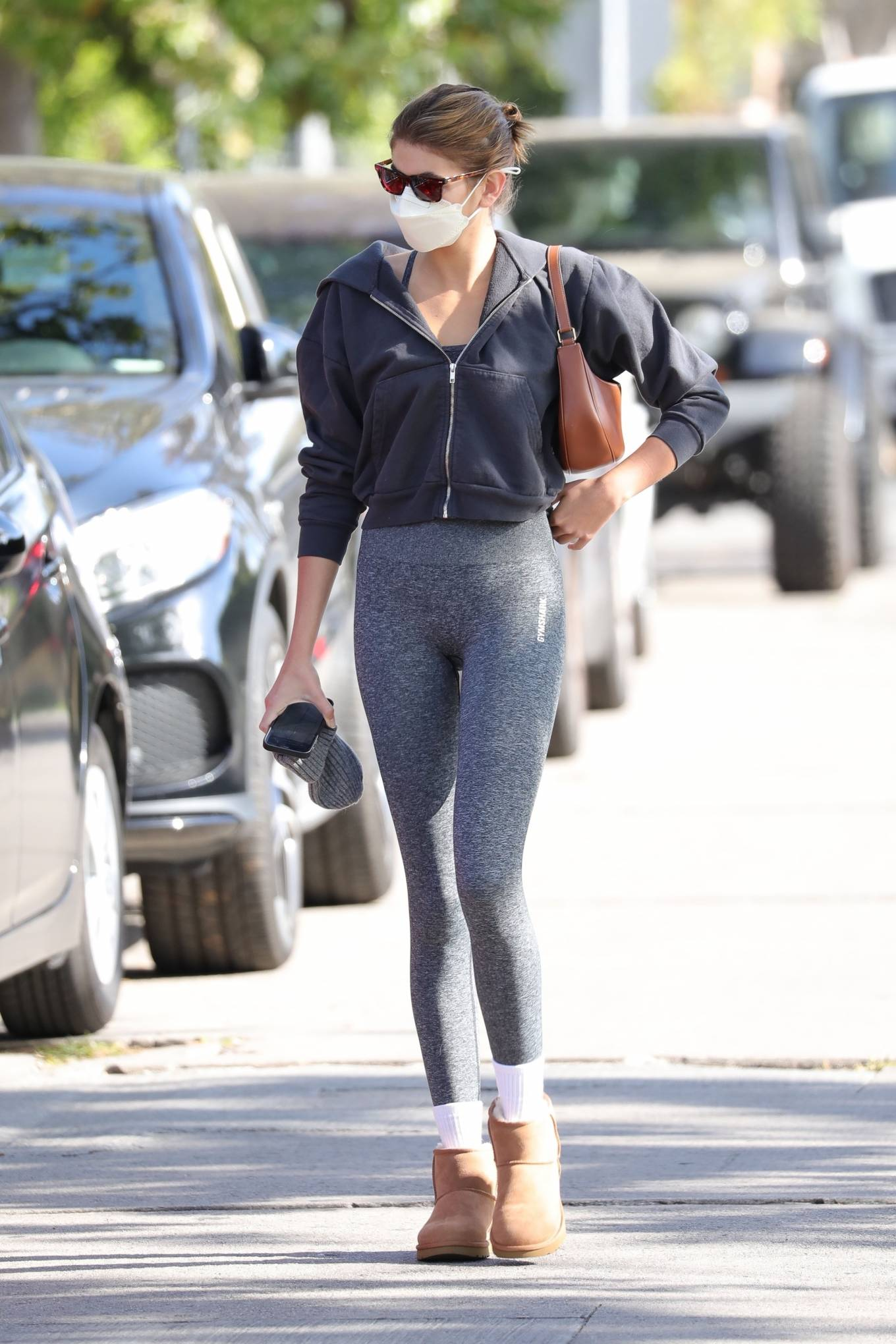 Kaia Gerber donning round chestnut brown Ugg ankle boots with flat heel