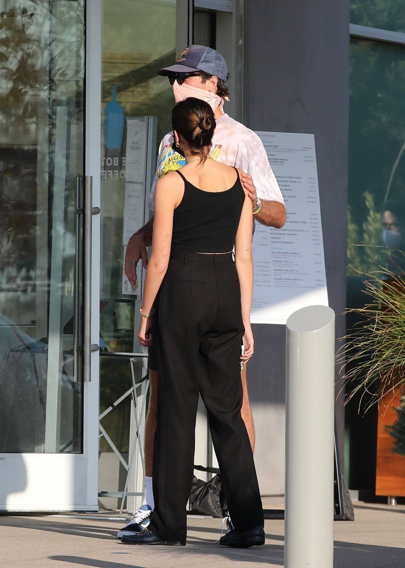 Kaia Gerber rocking a black basic tank top with thin shoulder strap and a scoop neck